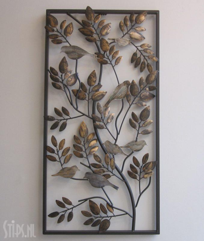 metalen wanddecoratie vogels tussen het bladerdak
